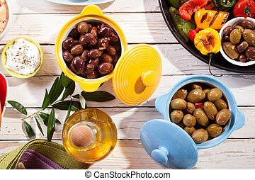 Olives and Grilled Vegetable Dish on Picnic Table - High ...