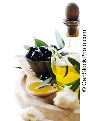 Olives and Olive Oil - A bottle of olive oil and olives over...