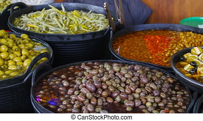 Olives for sale at a market - Canned olives for sale at a...