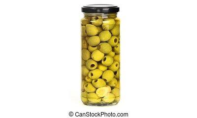Olives in a jar - Jar of ogreen olives on white background