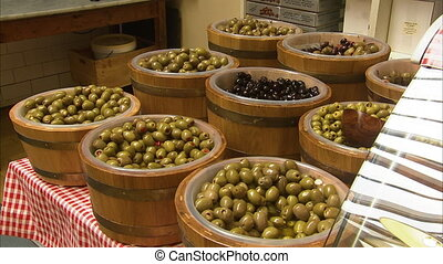 Olives in big containers - A medium shot of different olives...