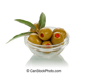 Green olives in glass bowl on white background