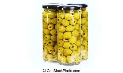 Olives in jars - Jars of ogreen olives on white background