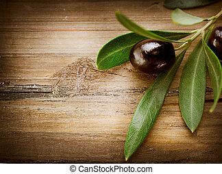 Olives over Wood Background
