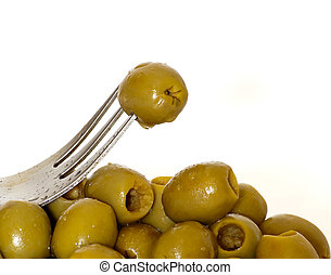 Olives - Raw boneless olives with an olive in a fork ...