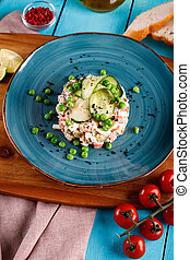 Olivier salad in a plate on the table