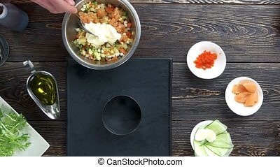 Olivier salad preparation. Chopped vegetables and...