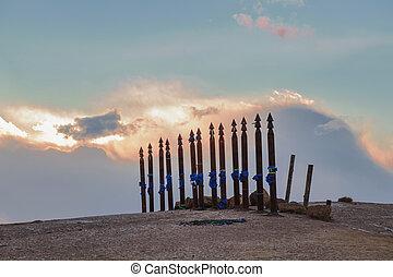 Olkhon, Russia, Buryat traditional pagan holy poles by Lake...