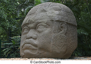 Olmec head - Statue of giant colossal Olmec head in Mexico