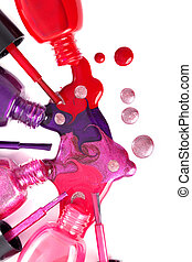 ?olored nail polish spilling from bottles - Image of bright-...