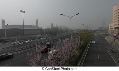Olympic park and 4th round high road in Beijing in a fog and...