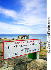 Omaha Beach D Day Second World War location sector signboard Vierville sur Mer, near Colleville and pier on background. France