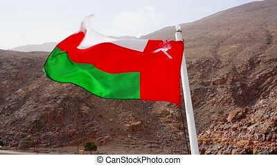 Oman flag back of a boat on sea. Musandam peninsula, Sultanate of Oman