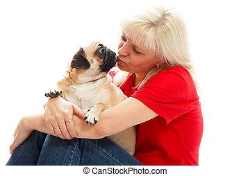 oman kissing a pug