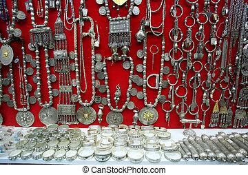 Silver jewellery display in a Omani shop window display