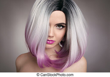 Ombre bob hairstyle blonde girl portrait. Purple makeup. Beautiful hair coloring woman. Fashion Trendy haircut. Blond model with shiny hairstyle. Concept Coloring Hair. Beauty Salon.