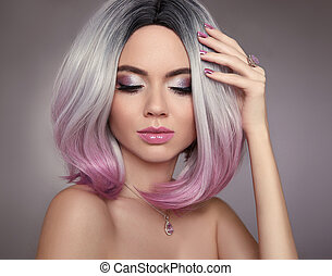Ombre bob pink hair woman. Glitter Makeup. Manicure nails. Beauty Portrait of blond model with short shiny hairstyle. Concept Coloring Hair. Fashion jewelry