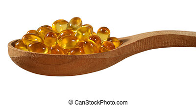 Omega-3 fish fat oil capsules in wooden spoon on a white