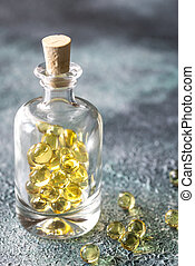 Omega-3 fish oil capsules in the glass bottle
