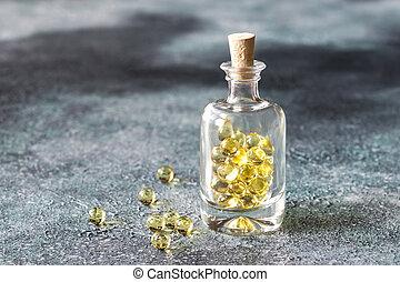 Omega-3 fish oil capsules in the glass bottle
