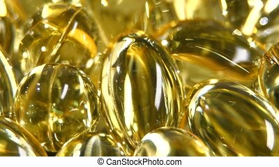 Omega 3 fish oil capsules, rotation, macro, close up