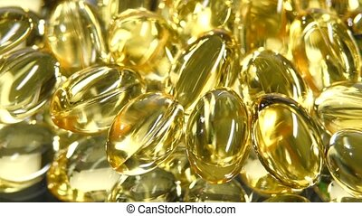Omega 3 fish oil capsules, rotation, reflection, close up