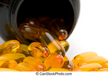 Omega 3 pills spilling from bottle - Close up view of Omega...