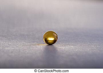 Omega capsule, macro - Omega capsule for dieting, macro.