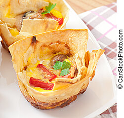 omelet in pita bread with tomato, bacon and mushrooms