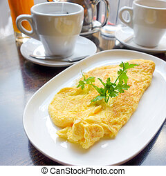 omelet with orange juice and green salad