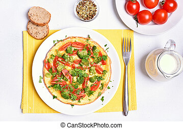 Omelet with vegetables, top view.