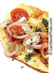 Omelette with cherry tomatoes, grilled red onion, goat's cheese, mozzarella and herbs. A delicious breakfast or brunch.