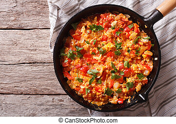 Omelette with vegetables in a pan close-up. top view horizontal