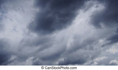 Ominous bank of heavy, clouds drifting across the sky in ...