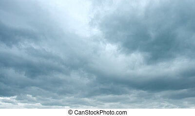 Ominous clouds drift slowly across the sky, threatening...