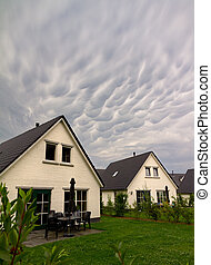 Ominous clouds - Mammatocumulus clouds above bungalow houses