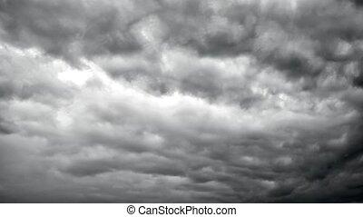 Ominous dark grey storm clouds in dramatic sky. Natural ...