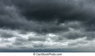 Ominous Gray Clouds drift Slowly across the Sky - Heavy and...