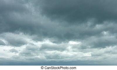 Ominous Gray Clouds Drifting in Timelapse. Video 1080p -...