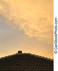 orange sky reflection on the roof
