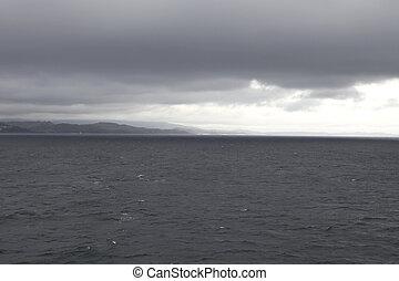 Dark ocean between mainland and isle of Skye in Scotland
