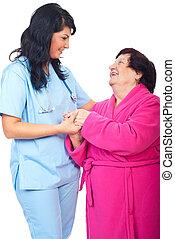 omsorgen, läkare, holdingen, äldre kvinna, räcker