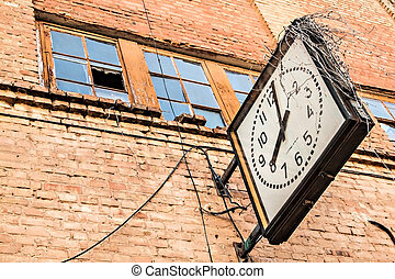on a brick wall of an old clock