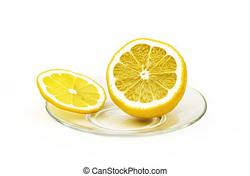 On a glass saucer is a slice of lemon and a half-cut lemon