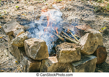 On a hot summer day, burn a fire in the forest.