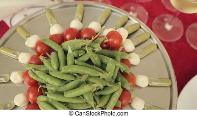 On a large tray canapes from tomatoes, mozzarella and sauce...