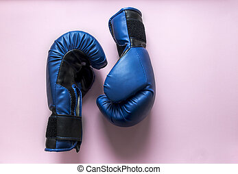 on a pink background two boxing gloves of blue color