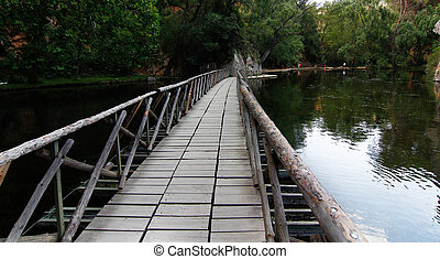 on a quiet lake floating wooden bridge