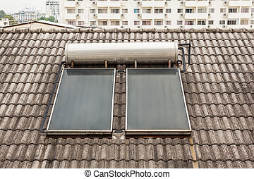 hot water collector - on a roof with pans there is a hot...