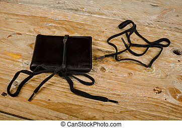 On a shoestring - Wallet on a shoestring, a financial...